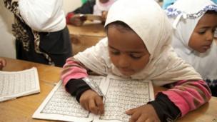 A child recites the Koran in Nairobi, Kenya, 29 June 2014