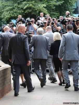 Rolf Harris arrives at Southwark Crown Court, London with daughter Bindi