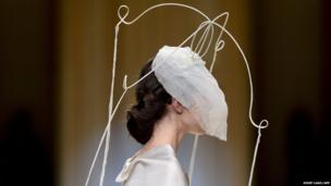 A model presents a creation by Natalie Capell during fashion week in Barcelona, Spain