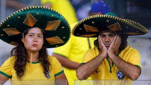 Brazil fans grieve at the Mineirao Stadium in Belo Horizonte, Brazil, July 8, 2014.