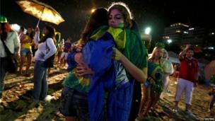 Brazil's fans at Copacabana beach in Rio de Janeiro, July 8, 2014.