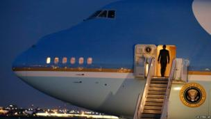 President Barack Obama walks aboard Air Force One at Dallas-Fort Worth International Airport before leaving for Austin, Texas