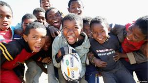 Children at the Father Pedro Foundation in Madagascar holding a World Cup rugby ball - Friday 4 July 2014