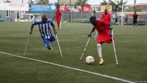Amputee footballers jostle for the ball during a practice match in Accra
