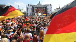 German football fans welcome home the World Cup team at the Brandenburg Gate, Berlin