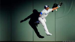 National League outfielder Yasiel Puig of the Los Angeles Dodgers is unable to catch a ball