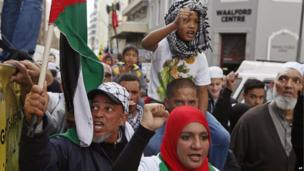 Palestinian supporters take part in a rally in Cape Town, South Africa, on 16 July 2014