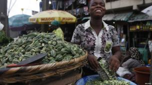 A girl sells vegetables in Nigeria's commercial capital Lagos on 11 July 2014