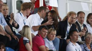 Prince Edward watches Scotland's women hockey match against Wales.