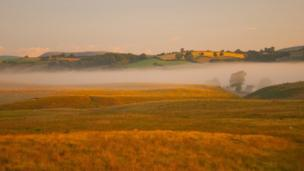 A cottage in Powys shrouded by the morning mist