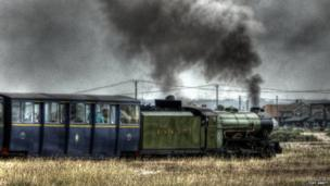 Green Goddess locomotive leaving Dungeness station
