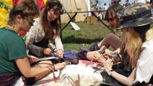 A group take part in craftwork at the festival