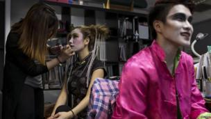 """A model has is made up to look like a Chinese ghost before a """"Funeral Fashion Show"""" during the Chinese Hungry Ghost Festival in Hong Kong on 10 August, 2014"""