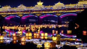 Water lanterns float on a river during Hungry Ghost Festival at Ziyuan County on 9 August, 2014 in Guilin, Guangxi Zhuang Autonomous Region of China