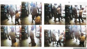 Images provided by the Ferguson Police Department show security camera footage from a convenience store in Ferguson, 9 August 2014, the day that Michael Brown was fatally shot by a police officer.