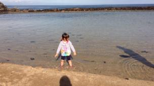 Girl on North Berwick beach