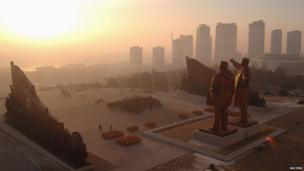 Statues of Kim Il-sung and Kim Jong-il against the Pyongyang skyline