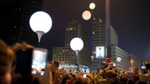 Row of illuminated balloons through Berlin