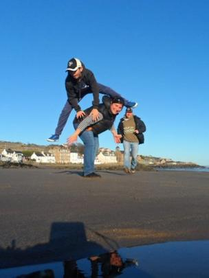 Game of leap frog on the beach