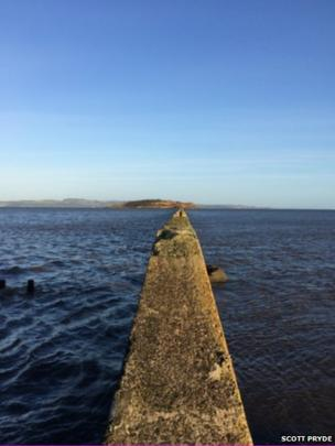 The causeway to Cramond Island at high tide.
