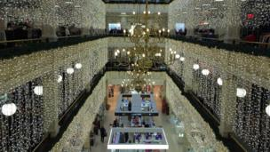 Kirsty Stewart (13) photographs the enchantment of Christmas lights in Frasers department store in Glasgow