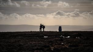 Walkers at the summit of Fan Gyhirych in the Brecon Beacons at New year, by Nick Dallimore