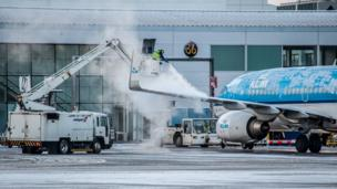 Plane being de-iced at airport