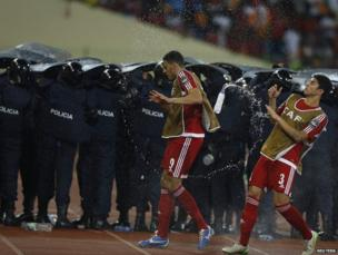 Equatorial Guinea's players dodge water bottles