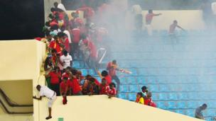 Fans flee from teargas