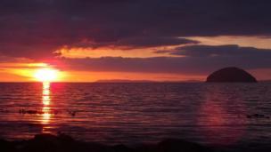 Sun setting over Ailsa Craig