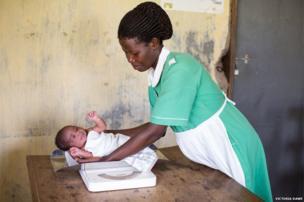 Baby Helen and a nurse