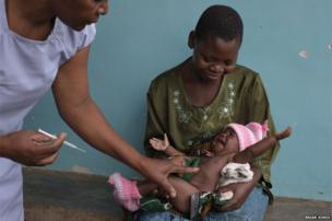 A baby about to be vaccinated