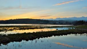 Sunset over the flooding River Loughor at Pontarddulais, during the recent supermoon. Picture by Howell Davies