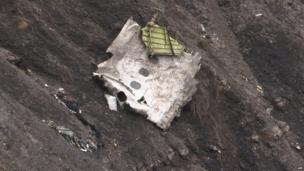 A screen grab taken from an AFP TV video on 24 March 2015 shows debris at the crash site of the Germanwings Airbus A320