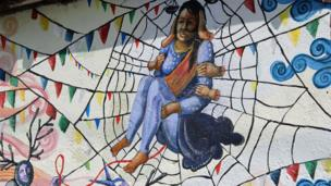Woman trapped in spider web by the Kolor Kathmandu collective