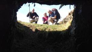 ramblers looking into hole
