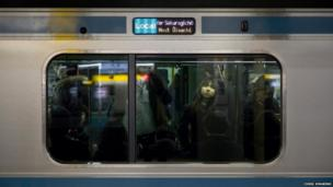 Woman on a train in Japan