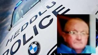 Police car and Thomas Williams, 68