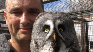 Jason Ashcroft with his great grey owl