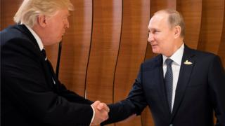 US President Donald Trump and Russia's President Vladimir Putin shake hands during the G20 Summit in Hamburg, Germany, 7 July 2017