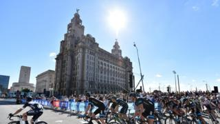 The riders start the race in front of the Royal Liver Building, on the streets of Liverpool during the 104.8 km first stage of the Tour of Britain cycle race on September 7, 2014