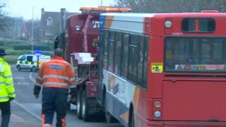 The bus being removed fro the scene
