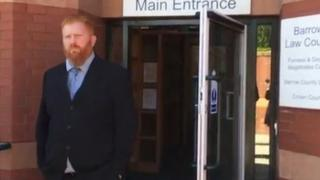 Christopher Cooper leaving court