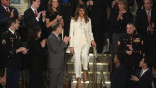 Melania Trump defies tradition to arrive alone at speech