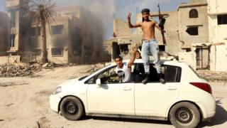Fighters loyal to Libya's Tobruk-based government celebrate as they come close to seizing the centre of Benghazi - 23 February 2016