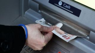 Money being taken out of an ATM