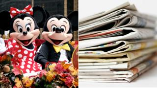 Mickey and Minnie Mouse and some newspapers