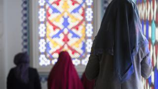 A Muslim woman is seen during midday prayers at a mosque in Berlin