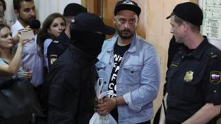 Kirill Serebrennikov (second from R) outside Basmanny district court in Moscow, Russia, 23 August 2017