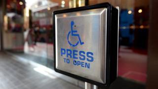 Button to open door for wheelchair